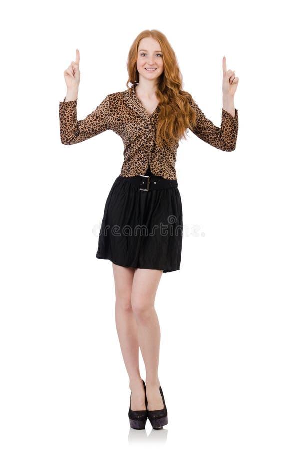 Ung dam i leopardblusen som isoleras på vit royaltyfri foto
