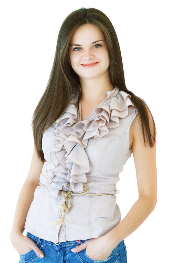 Ung elegant kvinna med ett leende på en vit bakgrund royaltyfri foto