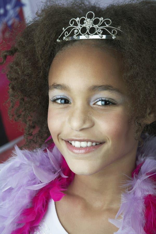 Ung flicka i makeup Tiara And Boa royaltyfria foton