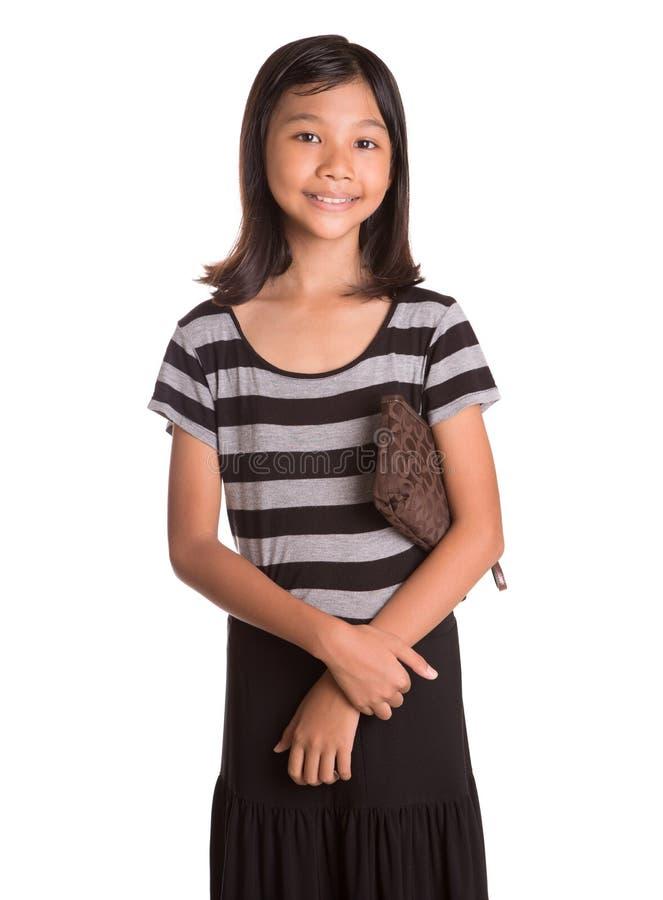 Ung flicka med brun handväska V royaltyfri fotografi