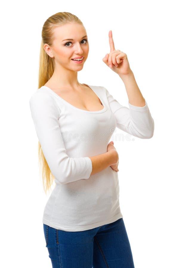 Ung flicka med det lyftta fingret arkivfoto
