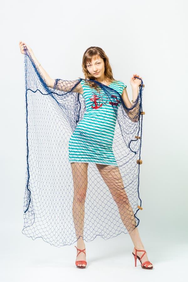 Ung flicka med havsnätverket royaltyfri fotografi