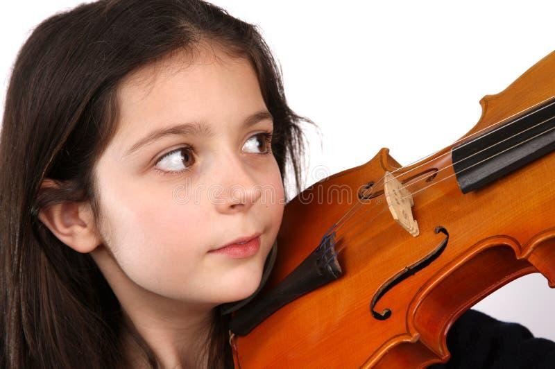 Ung flicka och fiol royaltyfria foton