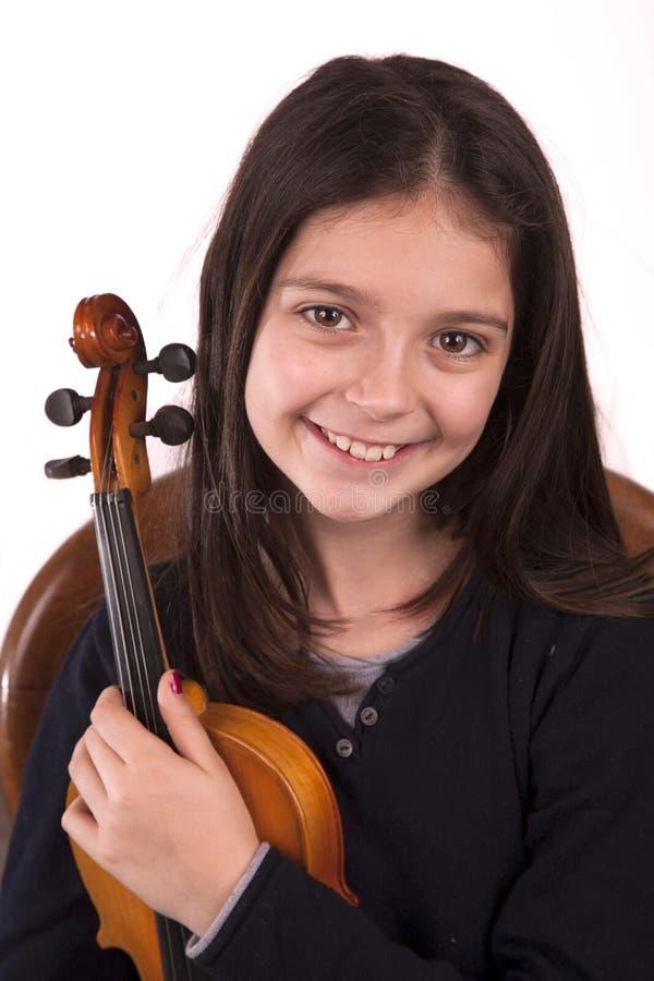 Ung flicka och fiol arkivbilder