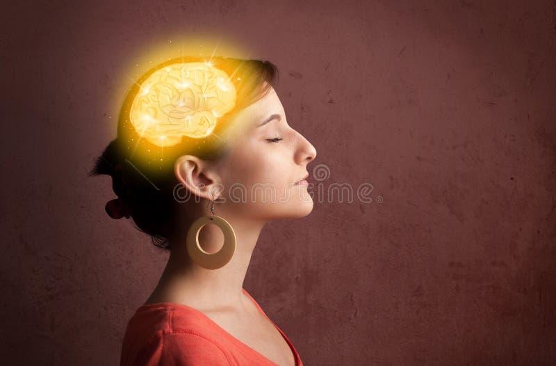 Ung flicka som tänker med den glödande hjärnillustrationen arkivbild