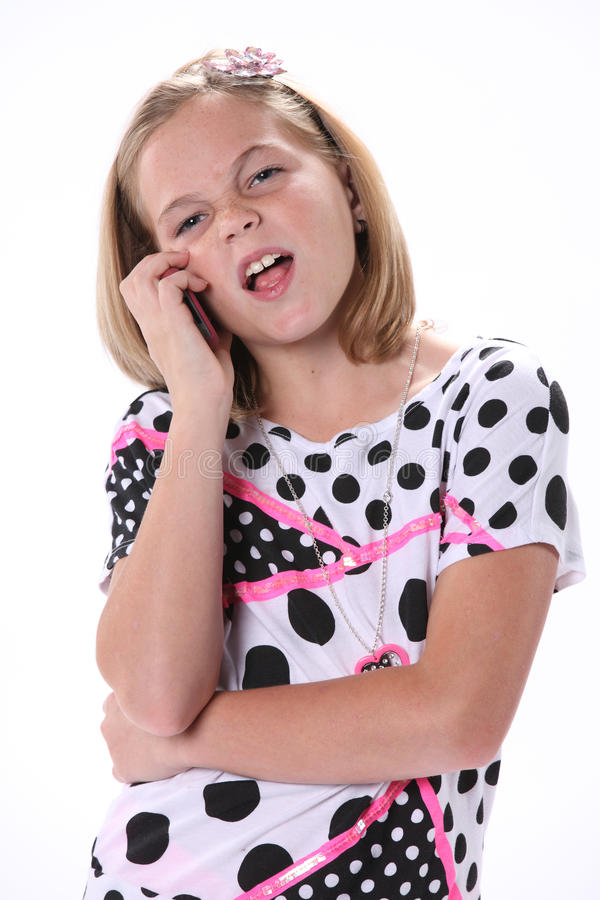 Ung flicka som talar på telefonen royaltyfri fotografi