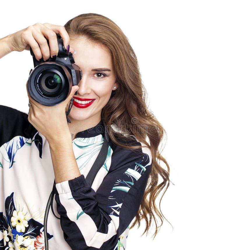 Ung gladlynt kvinna som tar en bild över vit bakgrund royaltyfria foton