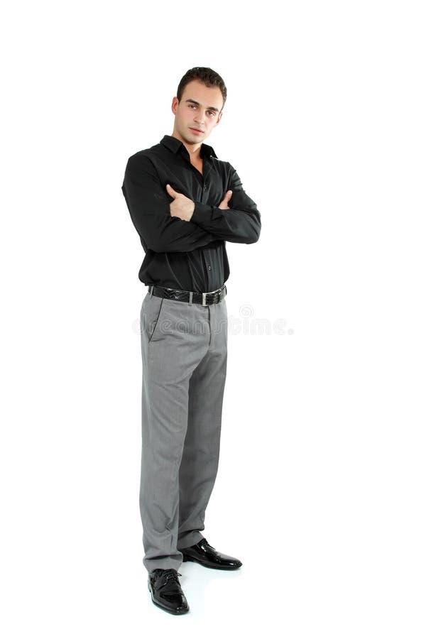 Ung gladlynt man i den svarta skjortan, full längdstående av attraen arkivbilder