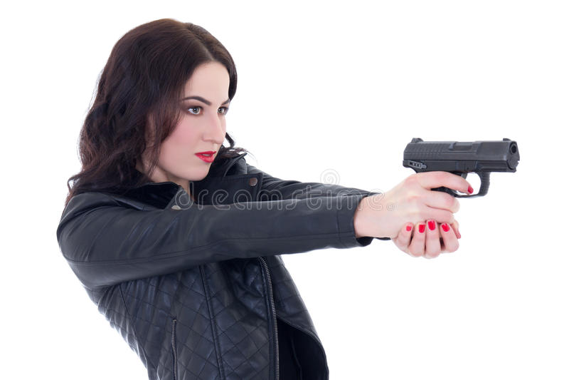 Ung härlig kvinna i skytte för läderomslag med vapenisolat arkivfoto