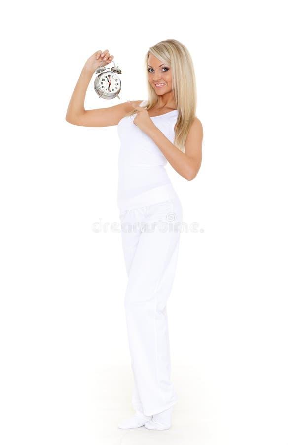Ung sportig kvinna med ringklockan. royaltyfri foto
