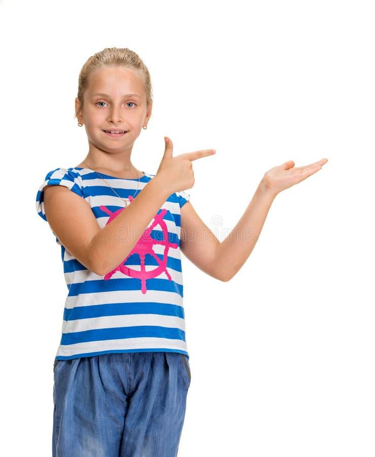 Ung härlig le flicka med att peka handen royaltyfri fotografi