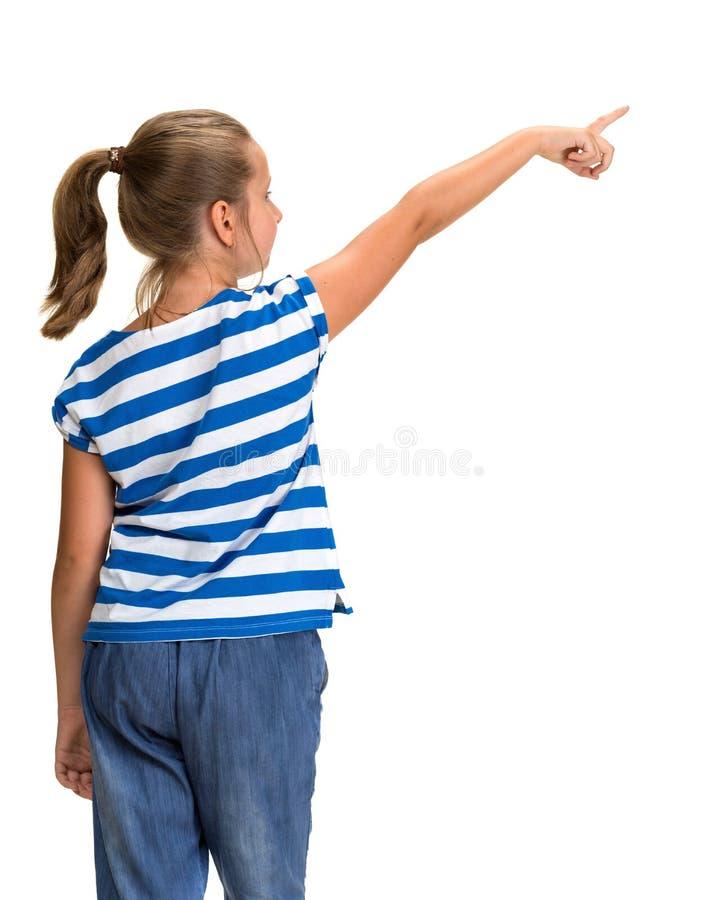 Ung härlig le flicka som pekar upp royaltyfri fotografi