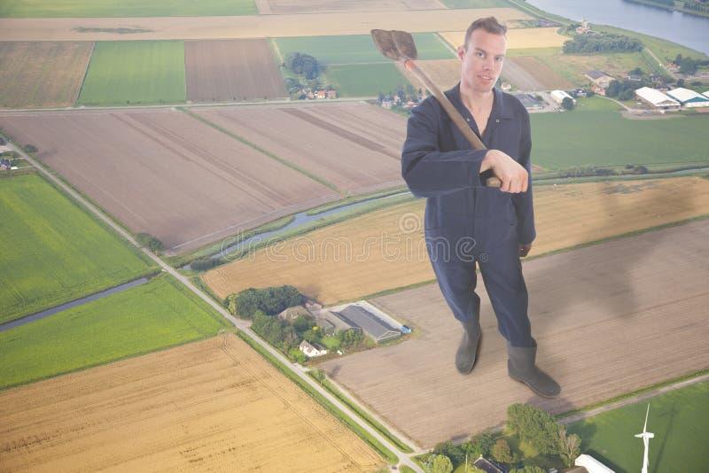 Ung jätte- bonde i flyg- sikt av det holländska bondelandskapet royaltyfria foton