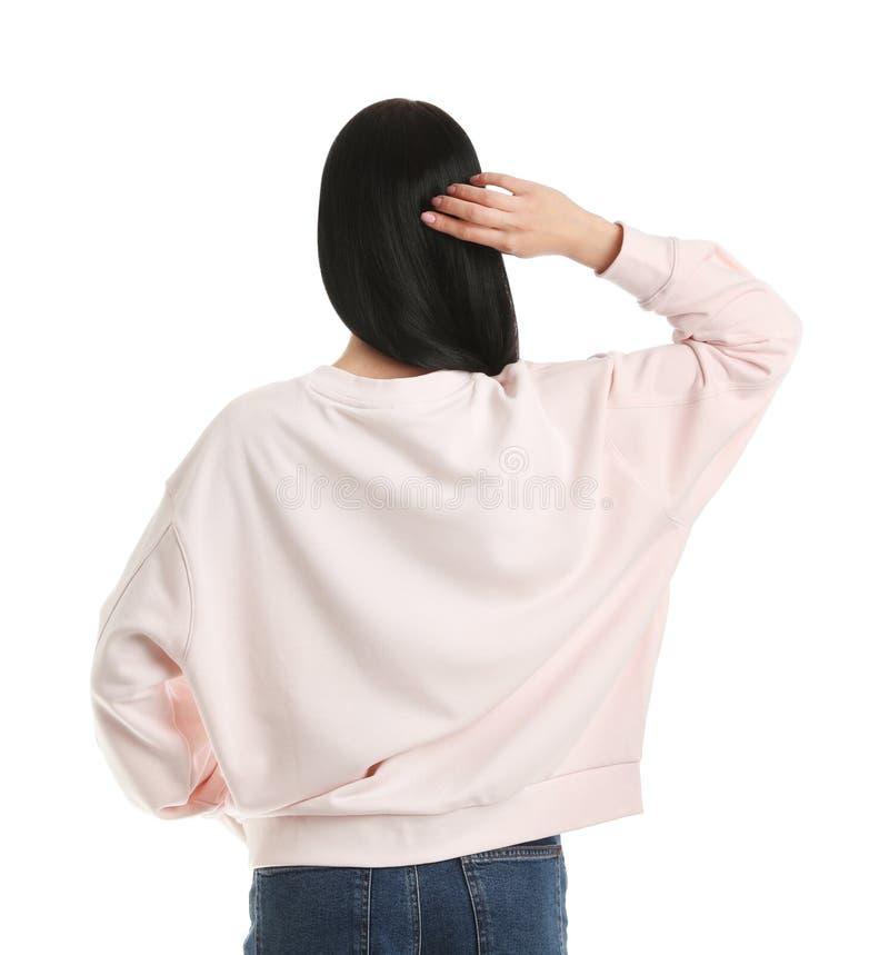Ung kvinna i den isolerade tröjan ?tl?je upp f?r design arkivfoton