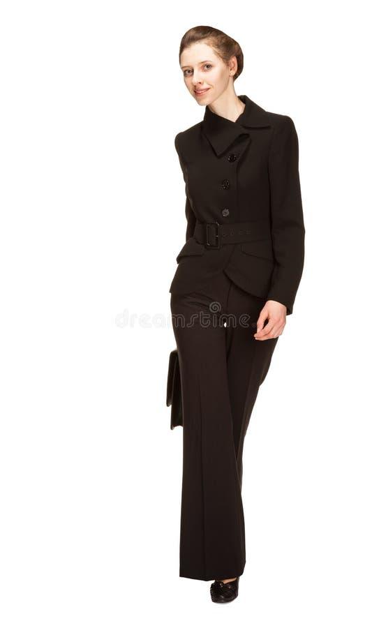 Ung kvinna i en affärsdräkt med portföljen royaltyfri foto