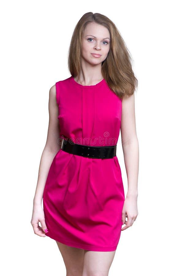 Ung kvinna i en kort klänning royaltyfri foto