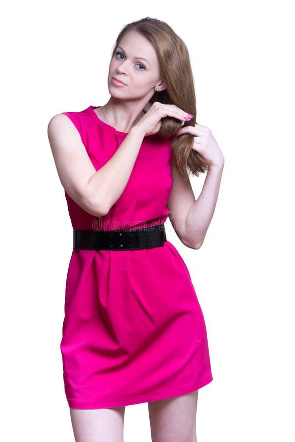 Ung kvinna i en kort klänning arkivfoton