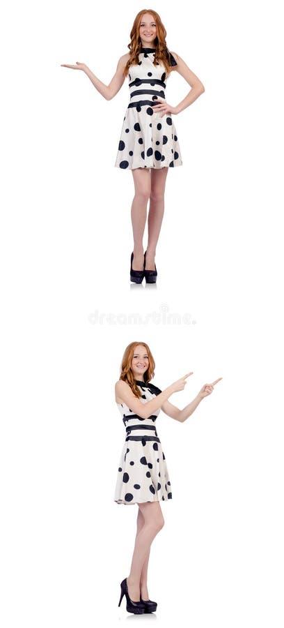 Ung kvinna i prickkl?nningen som isoleras p? vit royaltyfria foton