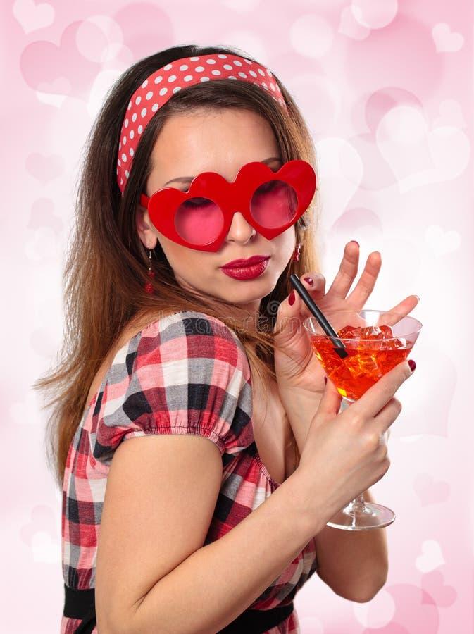 Ung kvinna med exponeringsglas royaltyfri bild
