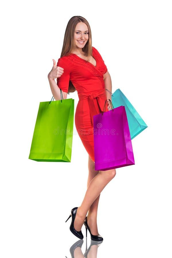 Ung kvinna med färgrika packar royaltyfri foto