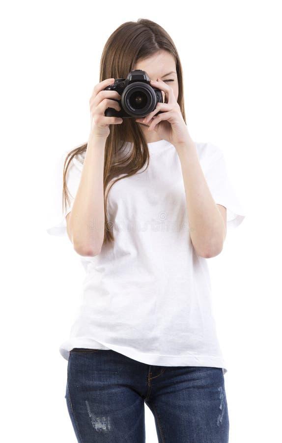 Ung kvinna med kameran royaltyfria bilder