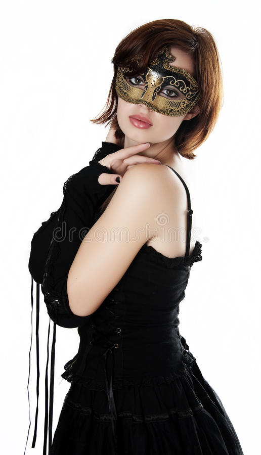 Ung kvinna med karnevalmaskeringen royaltyfri fotografi