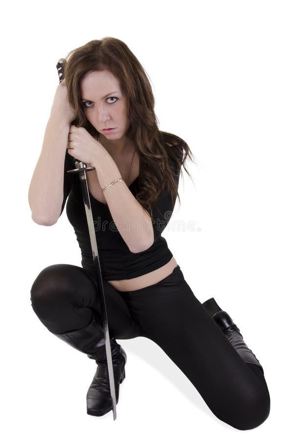 Ung kvinna med katana royaltyfri fotografi