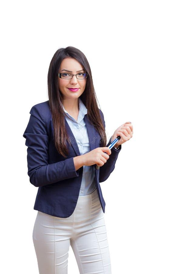 Ung kvinna med markören i hand arkivbilder