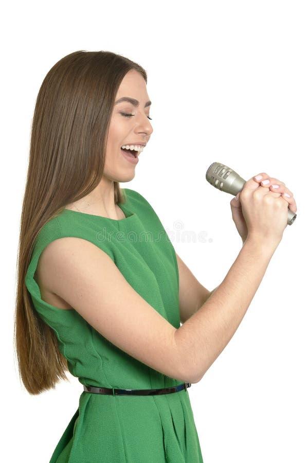 Ung kvinna med mikrofonen royaltyfria bilder