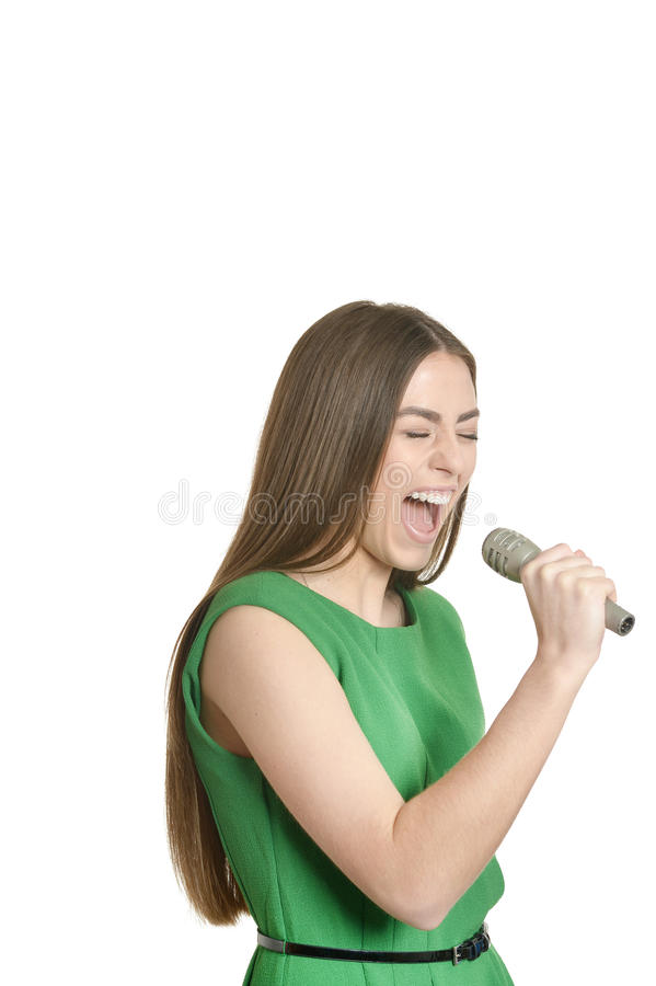 Ung kvinna med mikrofonen royaltyfri bild