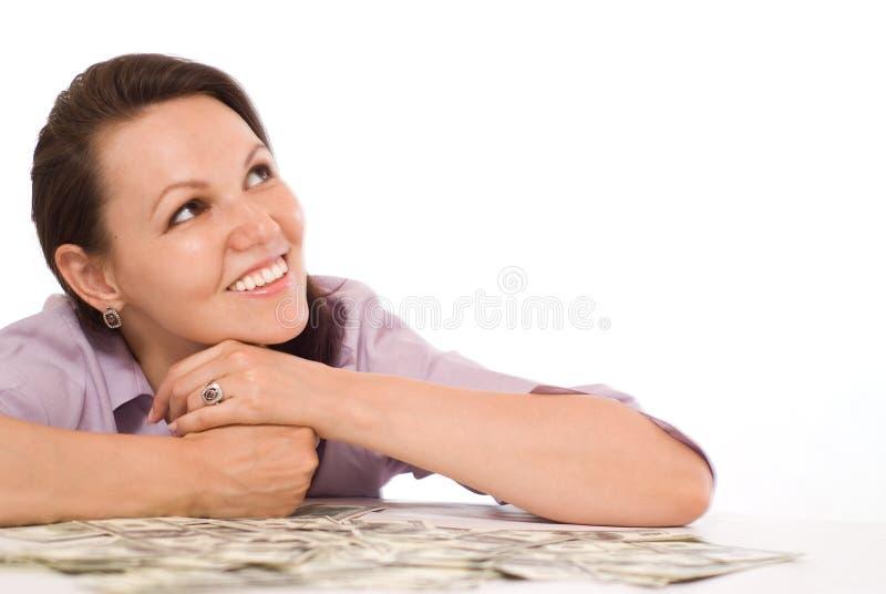 Ung kvinna med pengarna royaltyfria foton