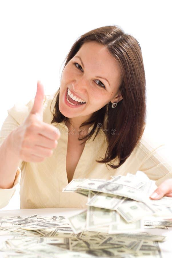 Ung kvinna med pengarna royaltyfria bilder
