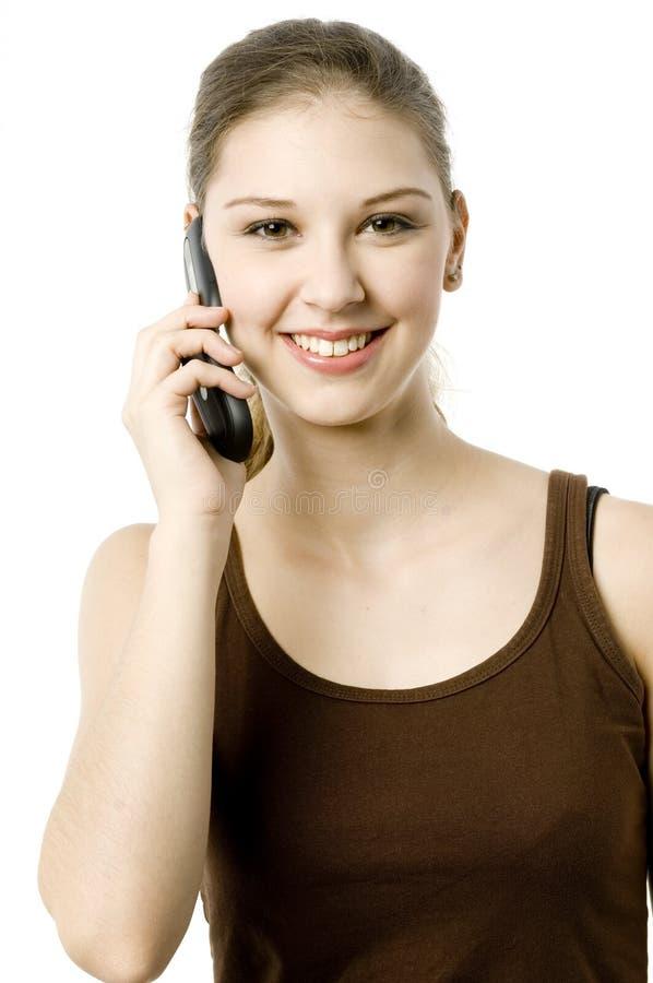 Ung kvinna på telefonen royaltyfria bilder