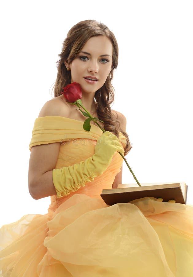 Ung kvinna som bär en prinsessadräkt royaltyfri fotografi