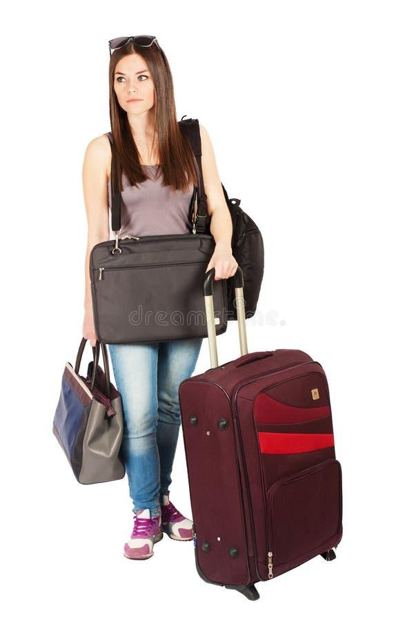 Ung kvinna som evakueras med hennes bagage arkivfoton