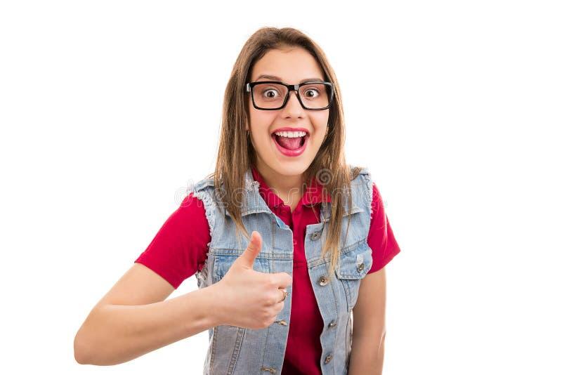 Ung kvinna som känner sig upphetsad ge upp tummen royaltyfria foton