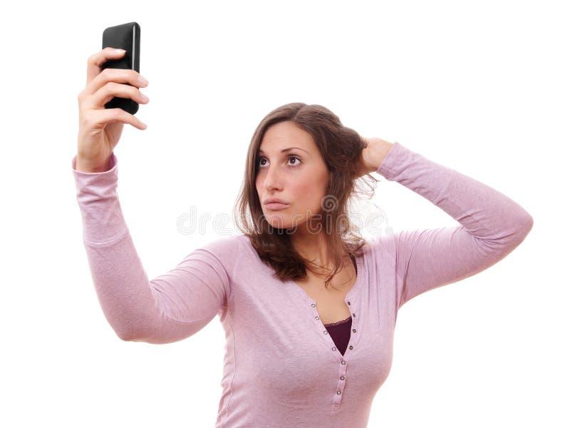 Ung kvinna som tar selfie royaltyfria bilder