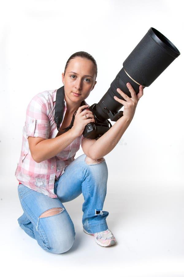 Ung kvinnafotograf royaltyfri fotografi
