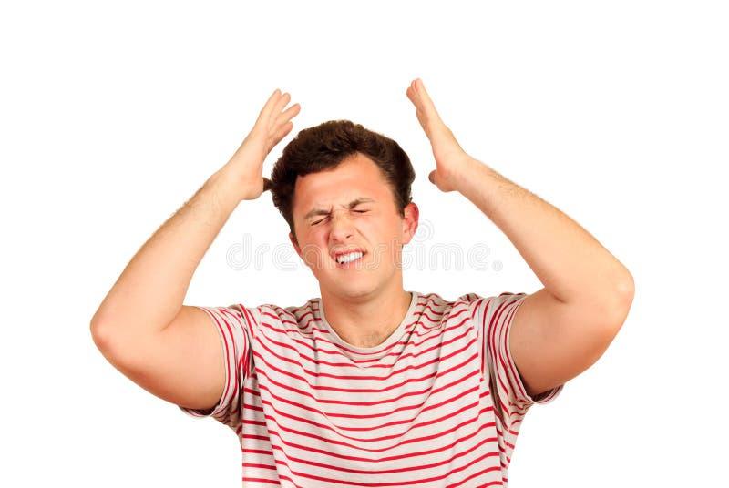 Ung ledsen thoughful man som har huvudvärk efter arbete emotionell man som isoleras på vit bakgrund arkivfoton