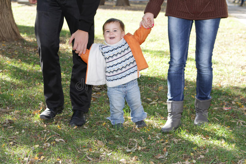 Ung lycklig familj med barnet royaltyfria bilder
