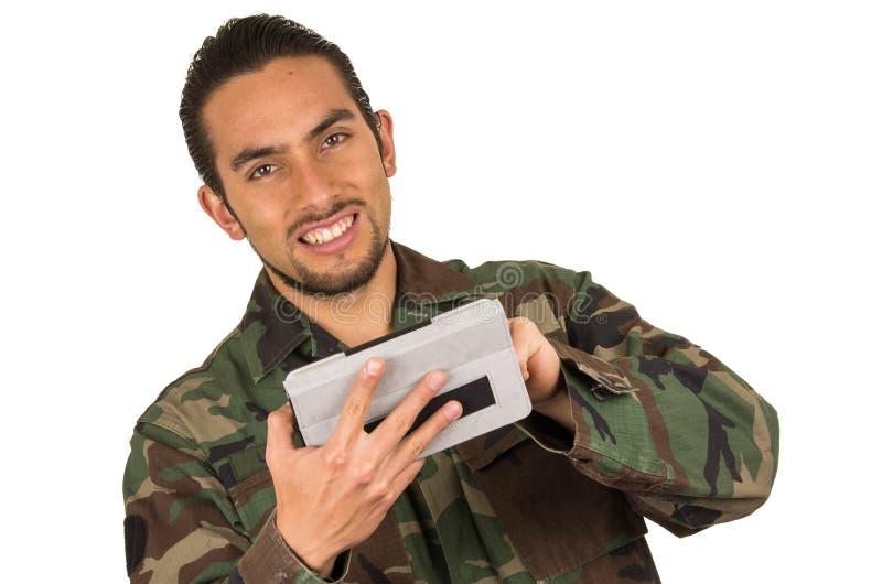 Ung lycklig man i militär likformig royaltyfri foto