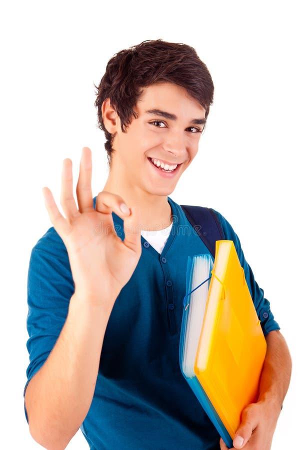 Ung lycklig student som visar det ok tecknet arkivfoton