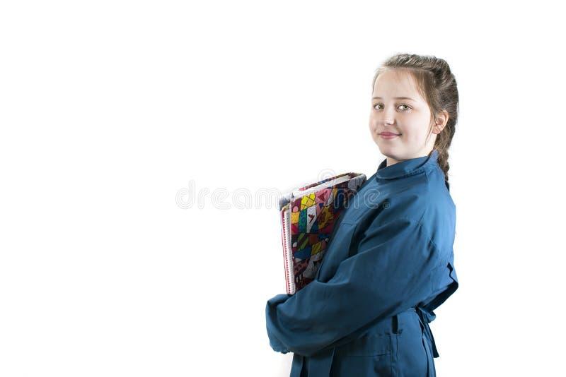 Ung man i skolalikformig royaltyfri foto