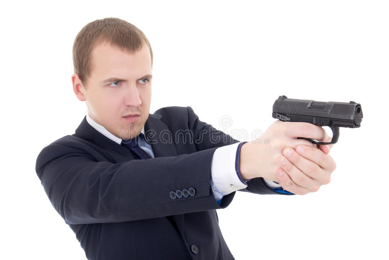 Ung man i skytte för affärsdräkt med vapnet som isoleras på vit royaltyfri foto