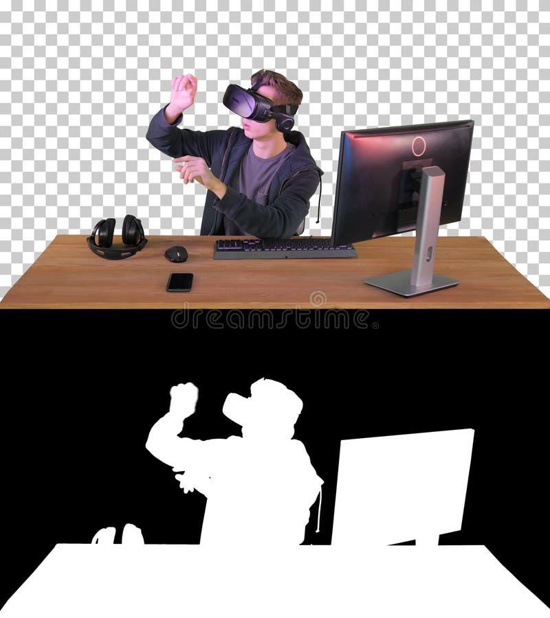 Ung man med vr headset som manipulerar virtuella objekt, Alpha Ch royaltyfri bild