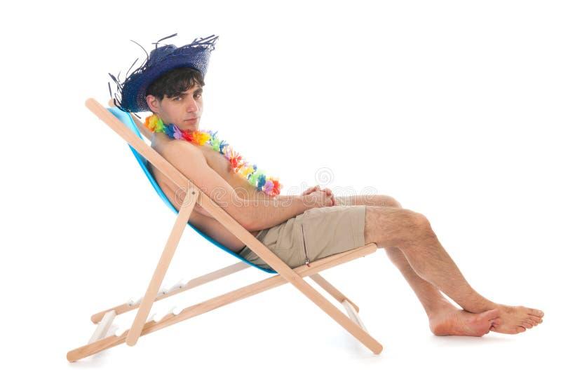 Ung man på stranden royaltyfri foto