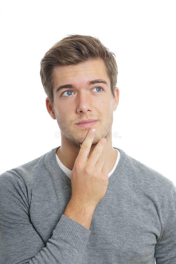 Ung man som är borttappad i tanke royaltyfri foto