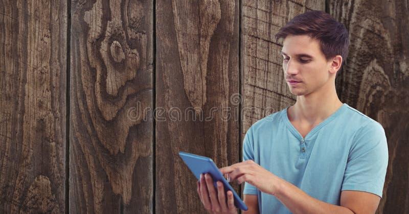 Ung man som använder minnestavlaPC mot väggen vektor illustrationer