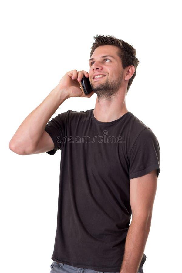 Ung man som talar på telefonen fotografering för bildbyråer