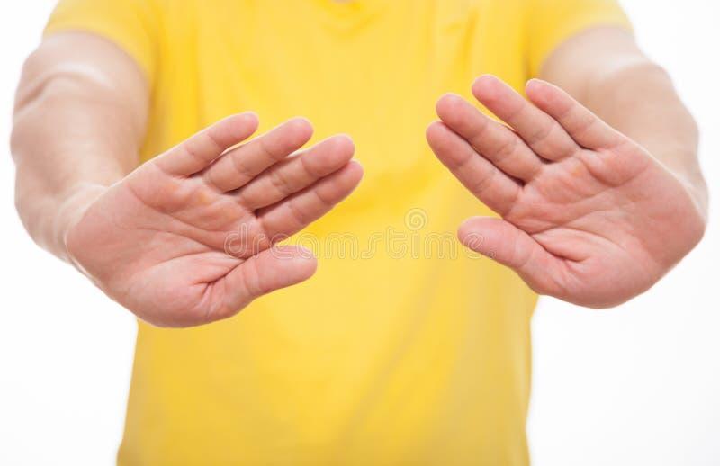 Ung man som visar att förbjuda av en gest royaltyfri fotografi